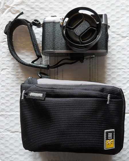 How do you carry your fuji x100?: Fujifilm X System / SLR Talk Forum