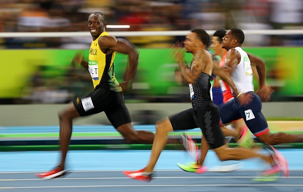 One iconic moment, two viral photos: Rio photographers capture Bolt's smile 1