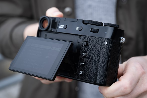 Tilting, touch-sensitive rear LCD