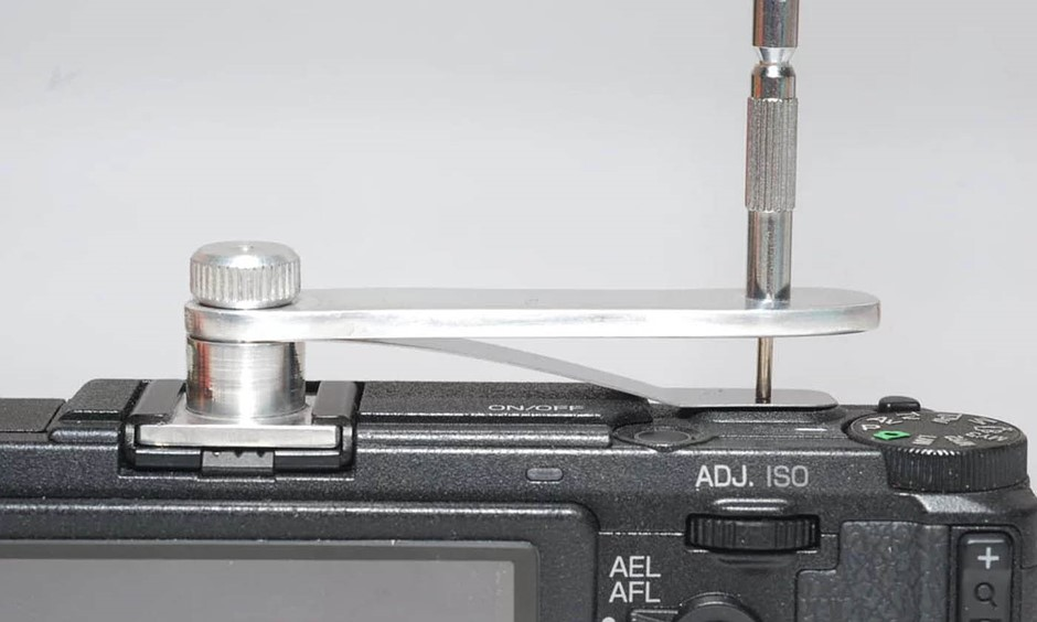 A DIY solution to adding a mechanical cable release to digital cameras with hotshoes